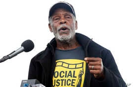 FILE - Actor Danny Glover speaks at the A.C.T. To End Racism rally, Washington, April 4, 2018.
