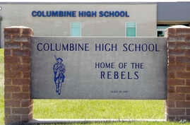 Signs outside Columbine High School are photographed, June 13, 2019, in Littleton, Colo.