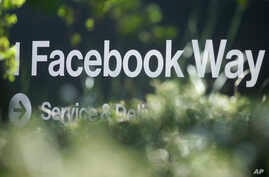 FILE - An address sign for Facebook Way is shown in Menlo Park, Calif, April 25, 2019..