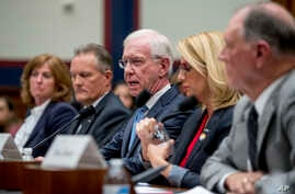 """FILE - Captain Chesley """"Sully"""" Sullenberger, along with representatives of several airline associations, speaks during a House Committee on Transportation and Infrastructure hearing on the Boeing 737 MAX status on Capitol Hill, Washington, June 19, 2019."""