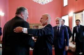 Secretary of State Mike Pompeo (L) is greeted by Afghan President Ashraf Ghani, at the Presidential Palace in Kabul, Afghanistan, June 25, 2019, during an unannounced visit.