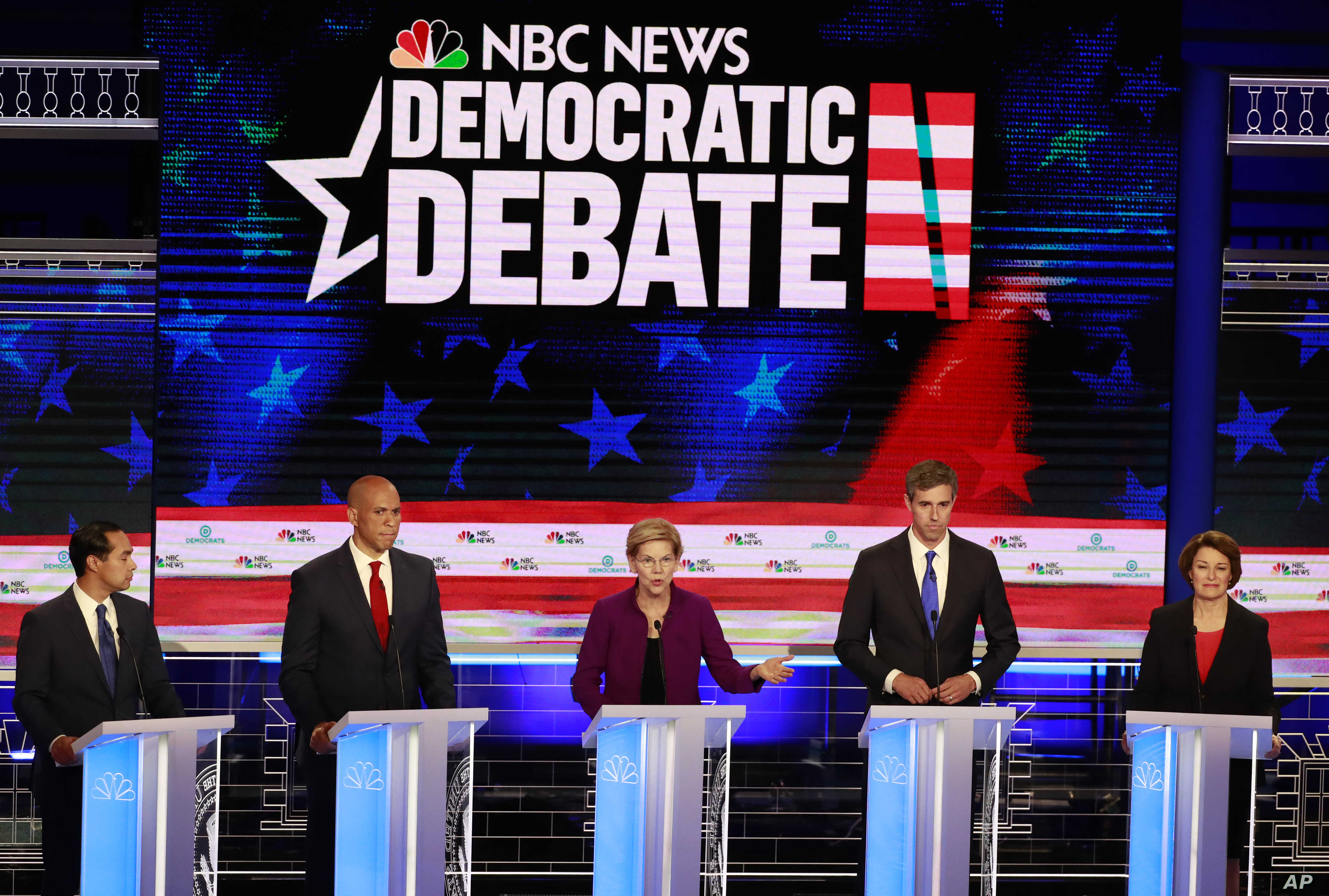 Democratic presidential candidate Sen. Elizabeth Warren, D-Mass., center, speaks during the Democratic primary debate hosted by NBC News at the Adrienne Arsht Center for the Performing Art, Wednesday, June 26, 2019, in Miami.