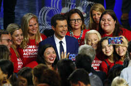 Democratic presidential candidate South Bend Mayor Pete Buttigieg poses with an advocacy group after the Democratic primary debate hosted by NBC News at the Adrienne Arsht Center for the Performing Art, June 27, 2019, in Miami, FL.