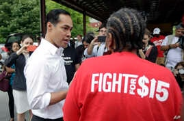In this May 23, 2019, photo, Democratic presidential candidate and former U.S. Department of Housing and Urban Development Julian Castro speaks with a supporter in Durham, N.C.