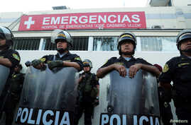 Police stand guard outside a hospital where Peru's former President Alan Garcia was taken after he shot himself, in Lima, Peru, April 17, 2019.