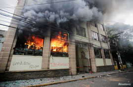 An exterior view of a building which was set alight by demonstrators during a protest against government plans to privatize health and education services, is seen in Tegucigalpa, Honduras, April 29, 2019.