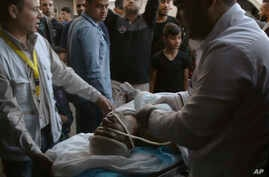 Medics move a seriously wounded youth who was shot in her head by Israeli troops during a protest at the Gaza Strip's border with Israel, at Shifa hospital in Gaza City, May 3, 2019.
