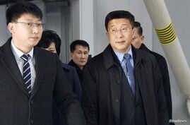 Kim Hyok Chol (R), North Korea's interlocutor leading negotiations with the United States, is pictured upon arrival at Beijing's international airport on his way to the Vietnamese capital Hanoi, in Beijing, China in this photo taken by Kyodo February 19, 2019.Picture taken February 19, 2019. Kyodo via REUTERS ATTENTION EDITORS - THIS IMAGE WAS PROVIDED BY A THIRD PARTY. JAPAN OUT. NO COMMERCIAL OR EDITORIAL SALES IN JAPAN. MANDATORY CREDIT: KYODO - RC12CF2E6820
