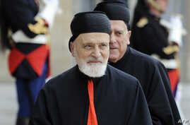 FILE - Lebanese Maronite Cardinal Nasrallah Boutros Sfeir arrives at the Elysee Palace in Paris, before a meeting with French President Nicolas Sarkozy, June 16, 2010. Lebanon's former Maronite patriarch, who wielded considerable political influence ...