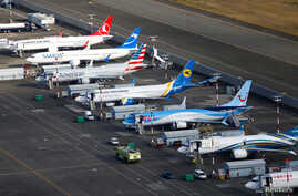 FILE - An aerial photo shows several Boeing 737 MAX airplanes grounded at Boeing Field in Seattle, Washington, March 21, 2019.