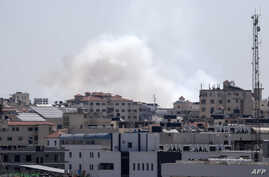 A picture taken from the Gaza Strip, May 4, 2019, shows smoke billowing after missiles were launched toward Israel.