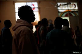 Cuban migrants, waiting for their appointment to request asylum in the U.S., attend a meeting at a church being used as a shelter in Ciudad Juarez, Mexico, April 6, 2019.