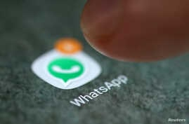 FILE - The WhatsApp app logo is seen on a smartphone in this picture illustration.