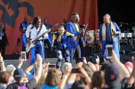 Earth, Wind & Fire members perform on the Acura Stage at the New Orleans Jazz & Heritage Festival in New Orleans, April 25, 2019.