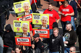"""Far-right supporters of the party """"Die Rechte (The Rights) carry placards of 90-year-old Ursula Haverbeck, who is imprisoned for her denial of the Holocaust during their May Day rally through the streets of Duisburg, Germany, May 1, 2019."""