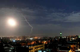FILE - This SANA news agency photo shows missiles flying near international airport in Damascus, Syria, Jan. 21, 2019. Syrian airdefensestargetedprojectiles fired from the direction of Israel May 17-18, 2019, Syrian state media said. Israel did...