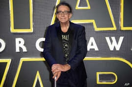 Peter Mayhew, who played Chewbacca in many Star Wars films, poses for photographers upon arrival at the European premiere of the film 'Star Wars: The Force Awakens ' in London, Dec. 16, 2015