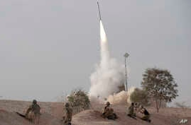 FILE - An Israeli missile is launched near the city of Be'er Sheva, southern Israel, Nov. 17, 2012.