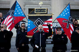 Commander Jeff Schoep of the National Socialist Movement, one of the largest white nationalist type groups in the country, speaks during a rally at the state capital in Little Rock, Arkansas, Nov. 10, 2018.