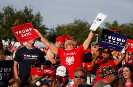 Supporters of President Donald Trump wait for his arrival to speak on May 8, 2019, in Panama City Beach, Fla.