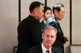 Acting U.S. Secretary of Defense Patrick Shanahan, center, and Chinese Minister of National Defense Gen. Wei Fenghe, right, attend a ministerial luncheon on the sidelines of the 18th International Institute for Strategic Studies (IISS) Shangri-la Dialogue