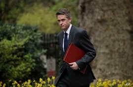 FILE - Britain's Defense Secretary Gavin Williamson arrives for a cabinet meeting in 10 Downing Street, London, April 2, 2019.