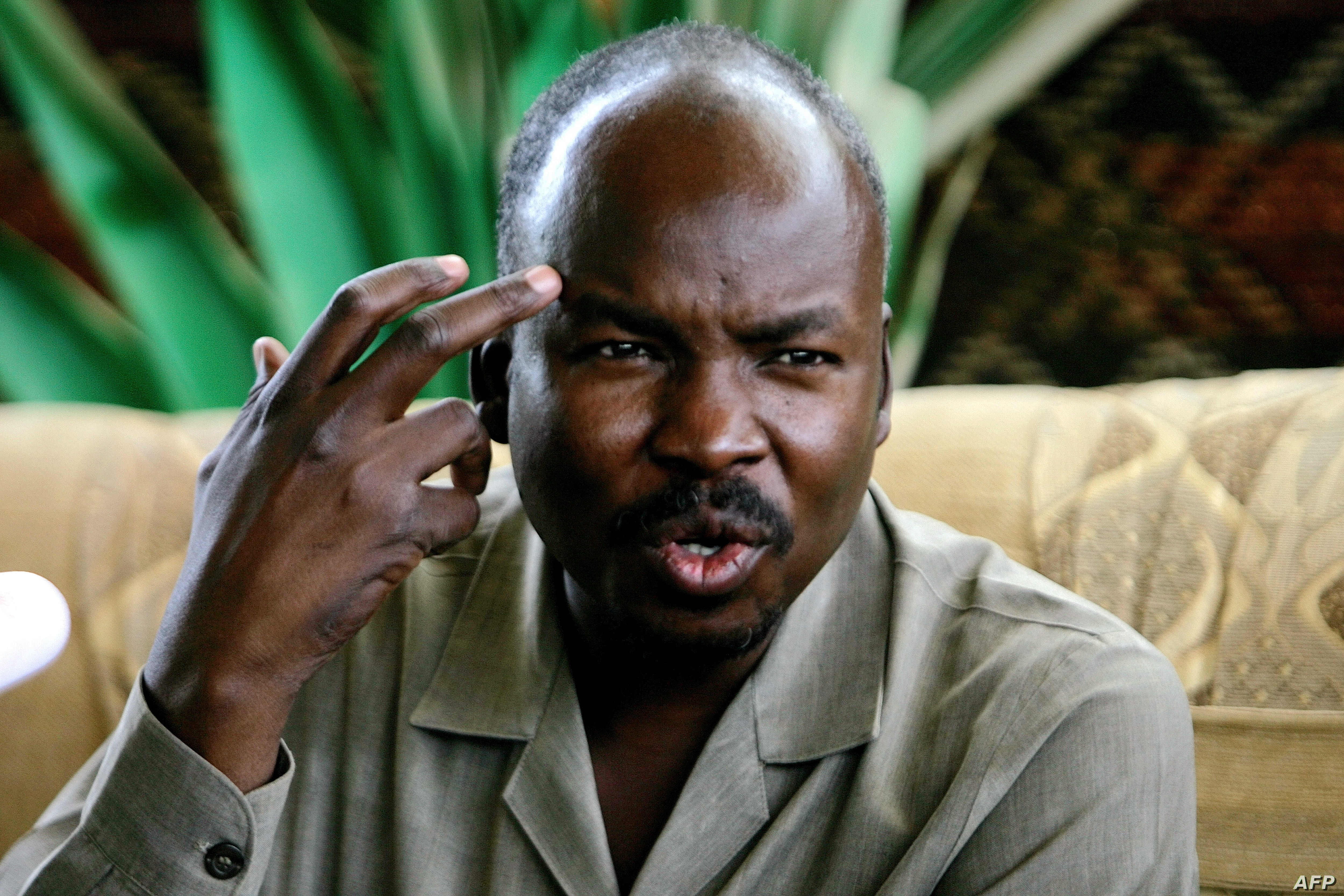 FILE - Ahmed Harun, who then was South Kordofan governor, gestures during a press conference in Talodi, Sudan, April 12, 2012. On April 20, 2019, Harun was one of several leaders of the former ruling National Congress Party who were arrested, a senio...