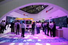 People visit Huawei's booth at an exhibition during the World Intelligence Congress in Tianjin, China May 16, 2019.