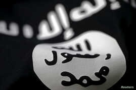 FILE- An Islamic State flag is seen in this photo illustration.