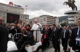 Pope Francis waves as he arrives to celebrate Mass in Macedonia Square, in Skopje, North Macedonia, May 7, 2019.