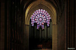 FILE -- A view shows the organ and a rose window inside the Notre Dame Cathedral in Paris, France, August 28, 2017.