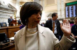 Baltimore Mayor Catherine Pugh walks on the Maryland House of Delegates chamber floor before Gov. Larry Hogan's annual State of the State address to a joint session of the legislature in Annapolis, Md., Wednesday, Jan. 30, 2019.