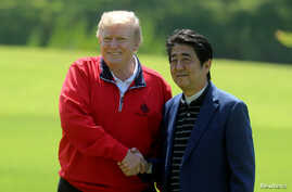 Japan's Prime Minister Shinzo Abe welcomes U.S. President Donald Trump upon his arrival at Mobara Country Club in Mobara, Chiba prefecture, Japan, May 26, 2019.