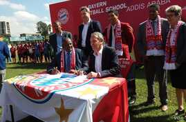 German champion football club Bayern Munich has signed an agreement to open its first soccer school in Africa, locating it in Addis Ababa, Ethiopia. European Football Federation President Esayas Jira, seated at left, and FC Bayern Munich AG executive...