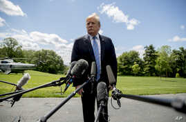 FILE - President Donald Trump listens to a question from a member of the media on the South Lawn of the White House in Washington, May 14, 2019.