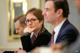 U.S. Ambassador to Ukraine Marie Yovanovitch, center, sits during her meeting with Ukrainian President Petro Poroshenko in Kyiv, Ukraine, March 6, 2019. Yovanovitch directed unusually scathing criticism at the Ukrainian government in remarks released...