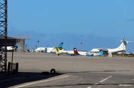FILE - Airplanes are seen at Mitiga airport, in Tripoli, Libya, April 8, 2019. A large group of African migrants were flown out this week from Libya to their home countries.