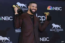 Drake poses in the press room with his awards at the Billboard Music Awards on May 1, 2019, at the MGM Grand Garden Arena in Las Vegas.
