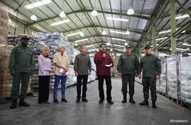 Venezuela's President Nicolas Maduro speaks during his visit to a packing center of the CLAP (Local Committees of Supply and Production) program, a Venezuelan government handout of basic food supplies, in Caracas, Venezuela, April 17, 2019.