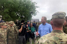 Acting U.S. Defense Secretary Patrick Shanahan speaks with troops and border patrol officials near the U.S.-Mexico border in McAllen, Texas, May 11, 2019.