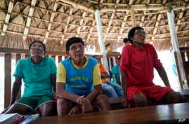 FILE - Indigenous elders attend a hearing on the Waimiri-Atroari reserve in Brazil's Amazon state, Feb. 27, 2019.