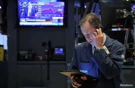 Traders work on the floor at the New York Stock Exchange (NYSE) in New York, U.S., May 14, 2019.
