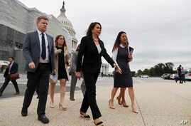 House Speaker Nancy Pelosi of Calif., second from right, arrives for a news conference on veteran suicide prevention with House Veterans' Committee members, Monday April 29, 2019, at the House Triangle in Washington.