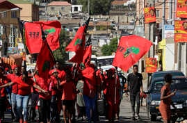 Members of the Economic Freedom Fighters (EFF) party make their way to attend a May Day rally in Alexandra Township,  South Africa, May 1, 2019.