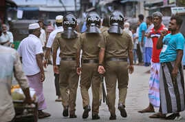 Sri Lankan policeman patrol in a Muslim neighborhood before Friday prayers in Colombo, Sri Lanka, April 26, 2019.