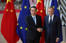 China's Premier Li Keqiang, left, shakes hands with European Council President Donald Tusk during an EU-China summit at the European Council headquarters in Brussels, Belgium, April 9, 2019.