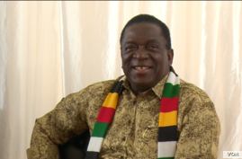 President Emmerson Mnangagwa stands behind Zimbabwe's currency switch to the bondnotes, in Victoria Falls, Zimbabwe, June 25, 2019. (Columbus Mavhunga/VOA)