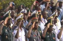 Cameroon military officials in Yaounde honor Boko Haram victims, June 21, 2019. (M. Kindzeka/VOA)