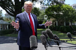 U.S. President Donald Trump talks to reporters as he departs for travel to the G-20 Summit in Osaka, Japan, at the White House in Washington, June 26, 2019.