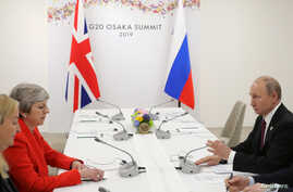 Russia's President Vladimir Putin and Britain's Prime Minister Theresa May attend a meeting on the sidelines of the G20 summit in Osaka, Japan June 28, 2019.